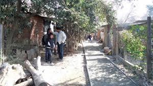Tendido eléctrico y cubas de agua en Barrio Saladillo